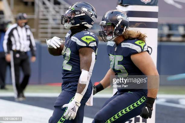 Chris Carson of the Seattle Seahawks celebrates with Chad Wheeler after scoring a 5 yard touchdown against the New York Jets during the second...