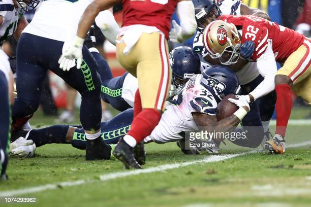 Chris Carson of the Seattle Seahawks dives for a touchdown against the San Francisco 49ers during their NFL game at Levi's Stadium on December 16...