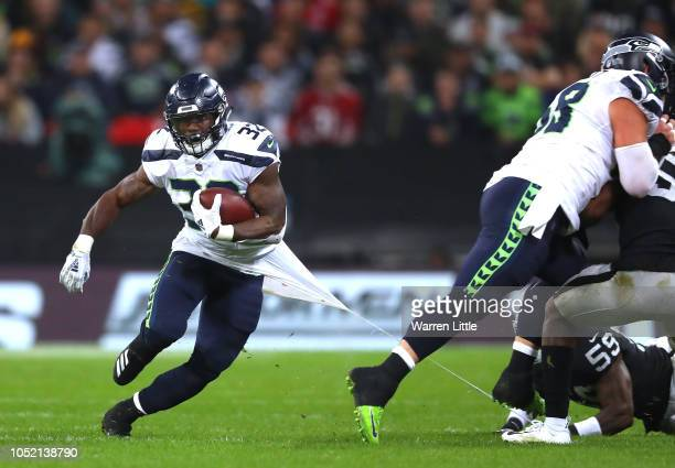 Chris Carson of the Seattle Seahawks is tackled during the NFL International Series game between Seattle Seahawks and Oakland Raiders at Wembley...