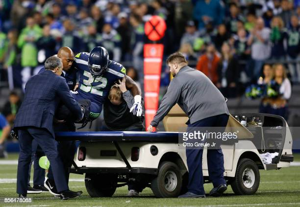 Chris Carson of the Seattle Seahawks is taken away on a cart after an injury in the fourth quarter of the game against the Indianapolis Colts at...