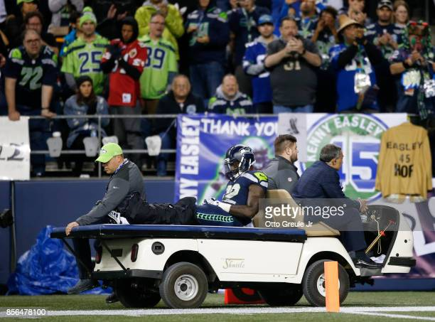 Chris Carson of the Seattle Seahawks is taken away on a cart after an injury in the fourth quarter of the game against the Indianapolis Colts in the...