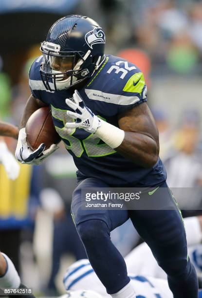 Chris Carson of the Seattle Seahawks runs against the Indianapolis Colts at CenturyLink Field on October 1 2017 in Seattle Washington