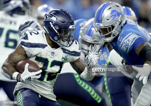 Chris Carson of the Seattle Seahawks runs for yardage against the Detroit Lions during the second half at Ford Field on October 28 2018 in Detroit...
