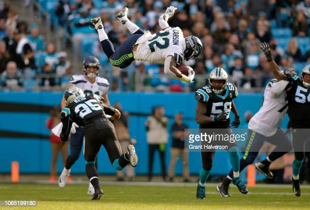 Chris Carson of the Seattle Seahawks runs the ball against Eric Reid and Thomas Davis of the Carolina Panthers in the third quarter during their game...