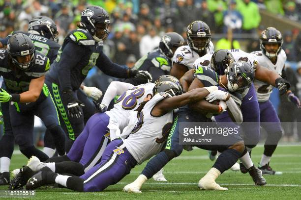 Chris Carson of the Seattle Seahawks runs the ball against the Baltimore Ravens during the first half of the game at CenturyLink Field on October 20,...