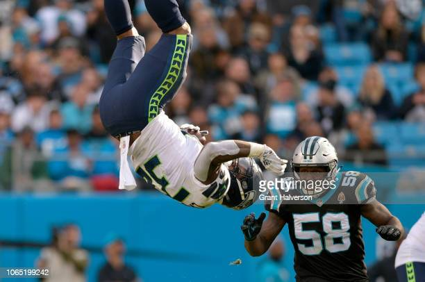 Chris Carson of the Seattle Seahawks runs the ball against Thomas Davis of the Carolina Panthers in the third quarter during their game at Bank of...