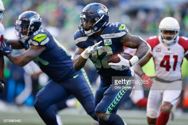 Chris Carson of the Seattle Seahawks runs the ball in the first half against the Arizona Cardinals at CenturyLink Field on December 30 2018 in...