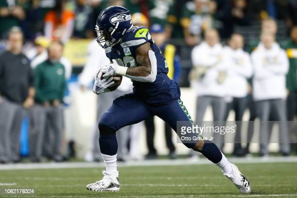 Chris Carson of the Seattle Seahawks runs the ball in the second half against the Green Bay Packers at CenturyLink Field on November 15 2018 in...