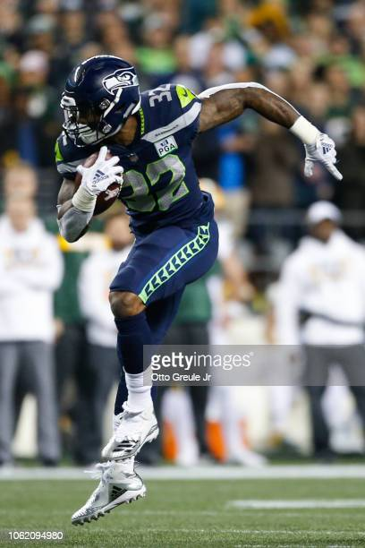 Chris Carson of the Seattle Seahawks runs the ball in the second quarter against the Green Bay Packers at CenturyLink Field on November 15 2018 in...