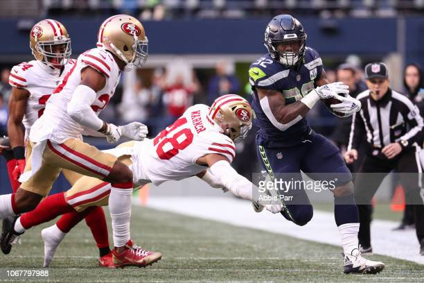 Chris Carson of the Seattle Seahawks runs the ball passed Fred Warner of the San Francisco 49ers in the third quarter at CenturyLink Field on...