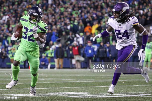 Chris Carson of the Seattle Seahawks runs the ball past Holton Hill of the Minnesota Vikings in the fourth quarter at CenturyLink Field on December...