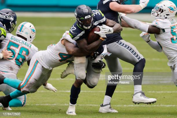 Chris Carson of the Seattle Seahawks runs with the ball against the Miami Dolphins during the second half at Hard Rock Stadium on October 04, 2020 in...