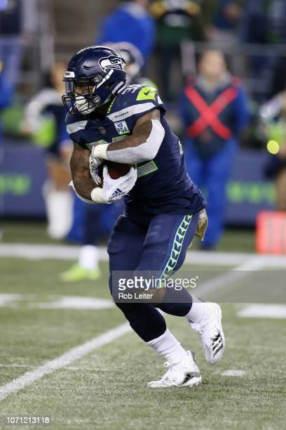 Chris Carson of the Seattle Seahawks runs with the ball during the game against the Green Bay Packers at CenturyLink Field on November 15 2018 in...