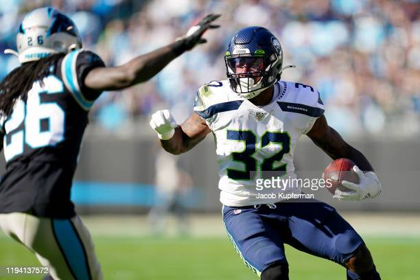 Chris Carson of the Seattle Seahawks runs with the ball during the first quarter during their game against the Carolina Panthers at Bank of America...
