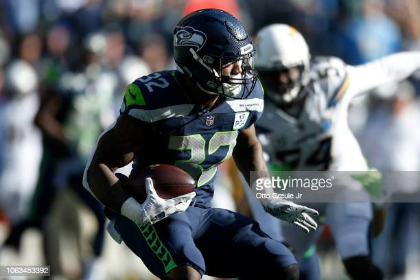 Chris Carson of the Seattle Seahawks runs with the ball in the first quarter against the Los Angeles Chargers at CenturyLink Field on November 04...