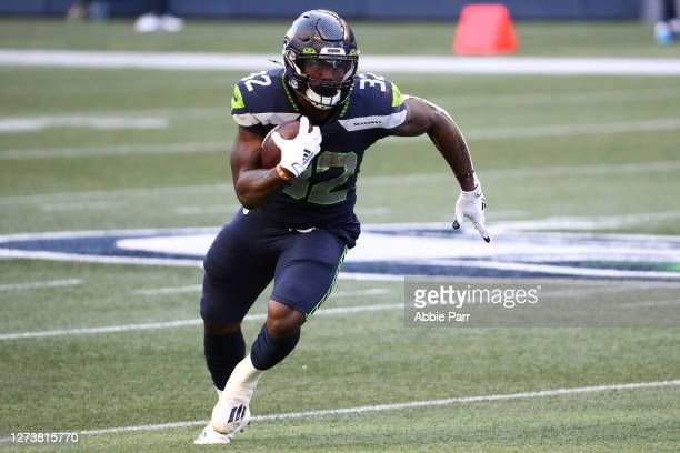 Chris Carson of the Seattle Seahawks runs with the ball in the first quarter against the New England Patriots at CenturyLink Field on September 20,...