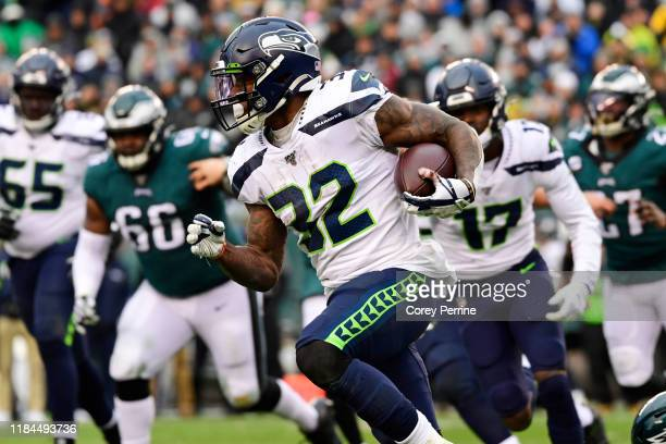 Chris Carson of the Seattle Seahawks rushes for yards during the fourth quarter at Lincoln Financial Field on November 24, 2019 in Philadelphia,...