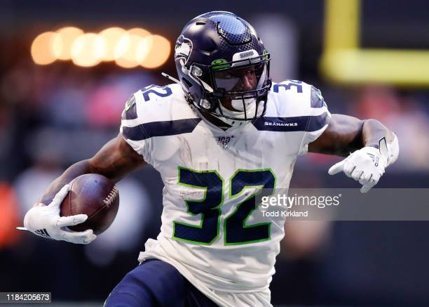 Chris Carson of the Seattle Seahawks rushes in the first half of an NFL game against the Atlanta Falcons at Mercedes-Benz Stadium on October 27, 2019...