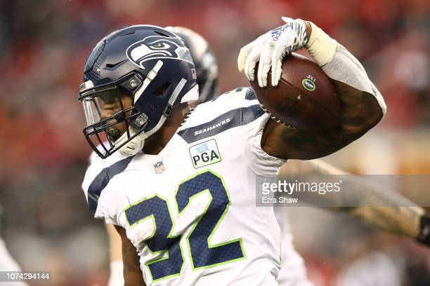 Chris Carson of the Seattle Seahawks rushes with the ball against the San Francisco 49ers during their NFL game at Levi's Stadium on December 16 2018...