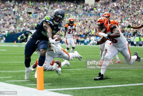 Chris Carson of the Seattle Seahawks scores a 10 yard touchdown in the second quarter against the Cincinnati Bengals at CenturyLink Field on...