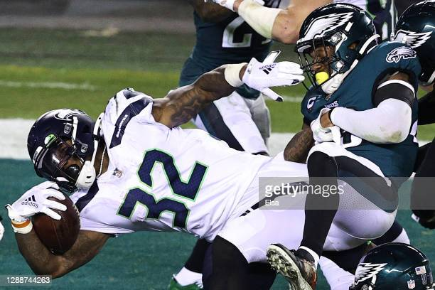 Chris Carson of the Seattle Seahawks scores a touchdown against Rodney McLeod of the Philadelphia Eagles during the second quarter at Lincoln...