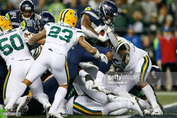 Chris Carson of the Seattle Seahawks scores a touchdown in the second quarter against the Green Bay Packers at CenturyLink Field on November 15 2018...