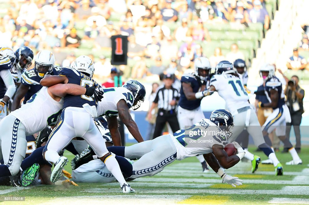 Chris Carson #32 of the Seattle Seahawks scores a touchdown in the second quarter against the Los Angeles Chargers at StubHub Center on August 13, 2017 in Carson, California.