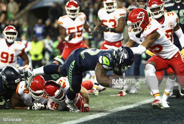 Chris Carson of the Seattle Seahawks scores a touchdown on a four yard rush during the first quarter of the game against the Kansas City Chiefs at...
