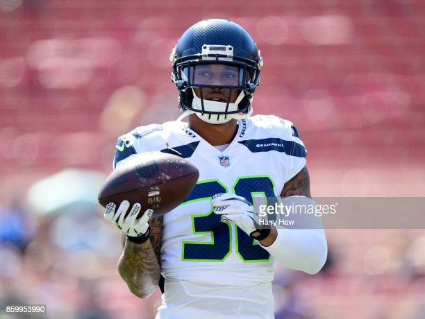 Chris Carson of the Seattle Seahawks warms up before the game against the Los Angeles Rams at Los Angeles Memorial Coliseum on October 8 2017 in Los...