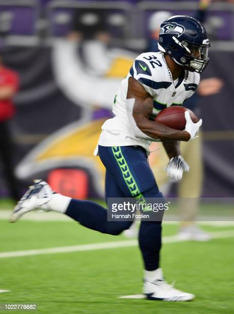 Chris Carson of the Seattle Seahawks warms up before the preseason game against the Minnesota Vikings on August 24 2018 at US Bank Stadium in...
