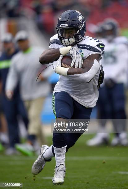 Chris Carson of the Seattle Seahawks warms up during pregame warm ups prior to the start of an NFL football game against the San Francisco 49ers at...
