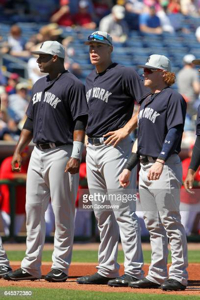 Chris Carter Aaron Judge and Clint Frazier of the Yankees pose together before the spring training game between the New York Yankees and the...
