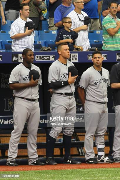 Chris Carter Aaron Judge and Gary Sanchez of the Yankees stand during the playing of the National Anthem before the MLB regular season game between...