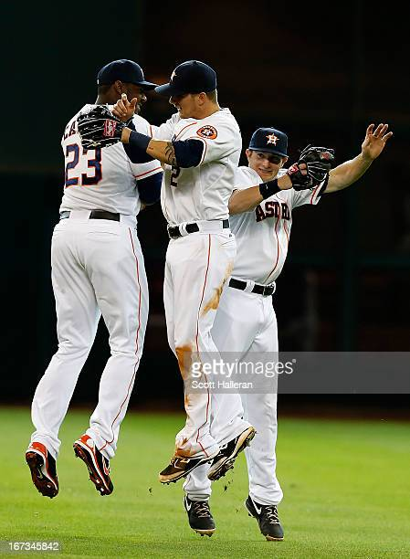 Chris Carter Brandon Barnes and Robbie Grossman of the Houston Astros celebrate in the outfield after defeating the Seattle Mariners 103 at Minute...