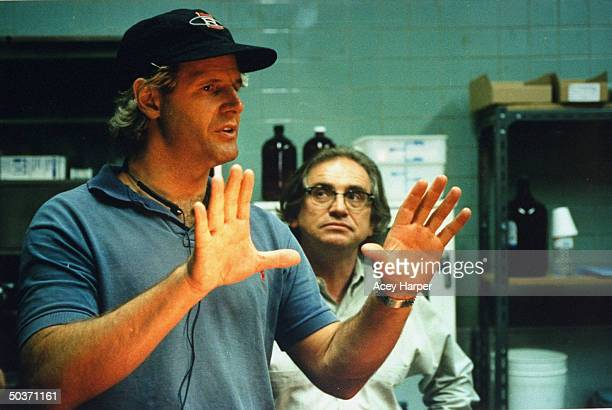 Chris Carter executive producer creator of cult hit TV series The XFiles standing w the show's director of photography John Baxter on the set of the...