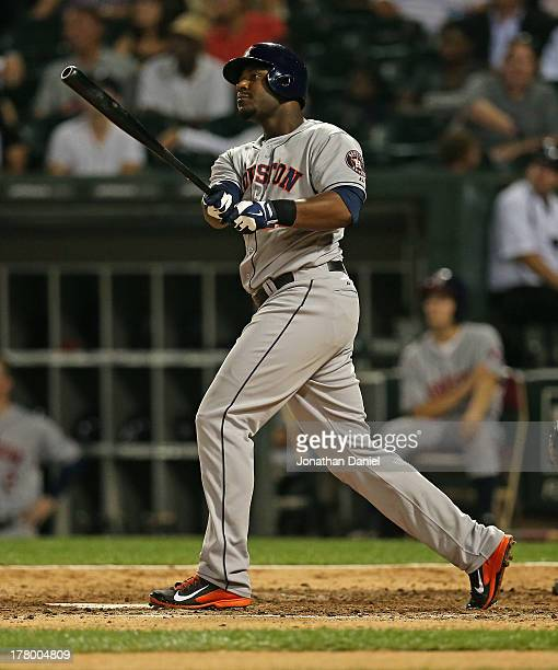 Chris Carter of the Houston Astros follows the flight of his tworun home run in the 5th inning against the Chicago White Sox at US Cellular Field on...