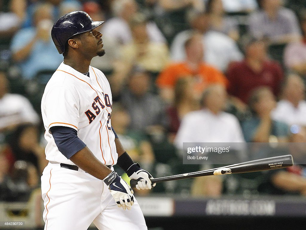 Chris Carter #23 of the Houston Astros hits a three-run home run in the eighth inning against the Oakland Athletics at Minute Maid Park on August 26, 2014 in Houston, Texas.