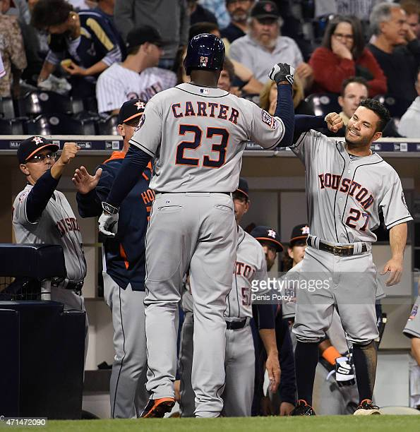 Chris Carter of the Houston Astros is congratulated after he hit a solo home run during the sixth inning of a baseball game against the San Diego...