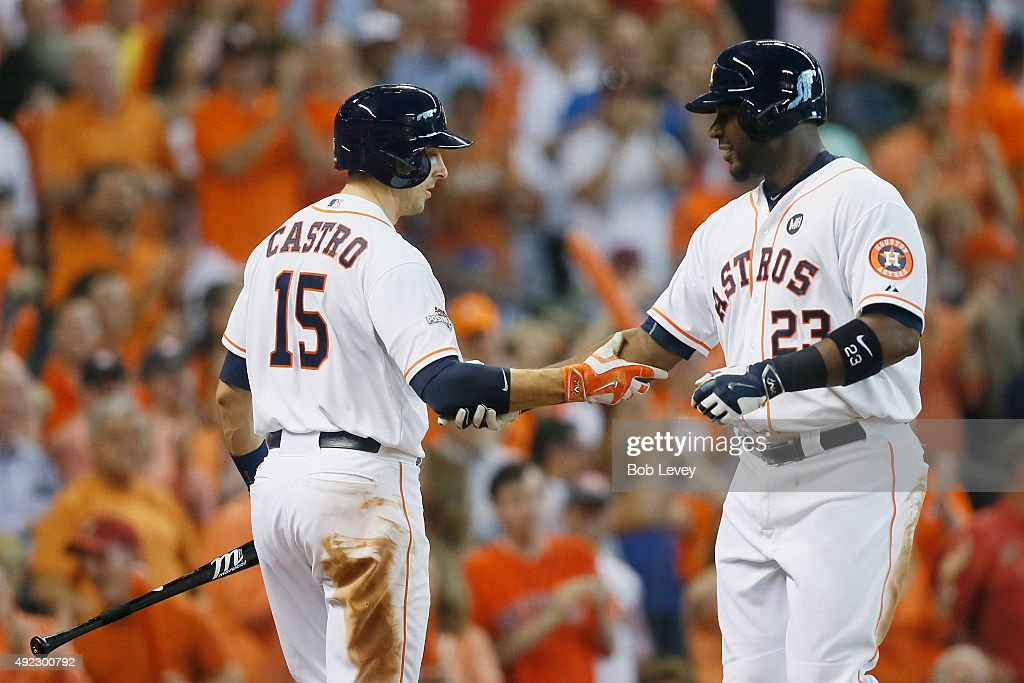 Chris Carter #23 of the Houston Astros is congratulated by Jason Castro #15 of the Houston Astros after hitting a solo home run in the seventh inning against the Kansas City Royals in game three of the American League Division Series at Minute Maid Park on October 11, 2015 in Houston, Texas.