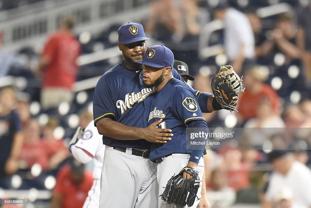 Chris Carter #33 of the Milwaukee Brewers and Jeremy Jeffress #21 celebrate win in after a baseball game against the Washington Nationals at Nationals Park on July 5, 2016 in Washington, DC.