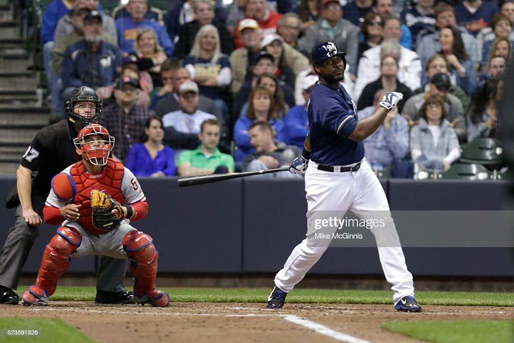 Chris Carter #33 of the Milwaukee Brewers hits a RBI double scoring Jonathan Lucroy in the third inning against the Philadelphia Phillies at Miller Park on April 23, 2016 in Milwaukee, Wisconsin.