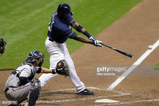Chris Carter of the Milwaukee Brewers hits RBI double scoring Ryan Braun in the fourth inning against the Minnesota Twins at Miller Park on April 20,...