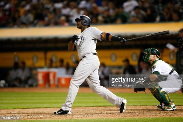 Chris Carter of the New York Yankees bats during the game against the Oakland Athletics at the Oakland Alameda Coliseum on June 15 2017 in Oakland...