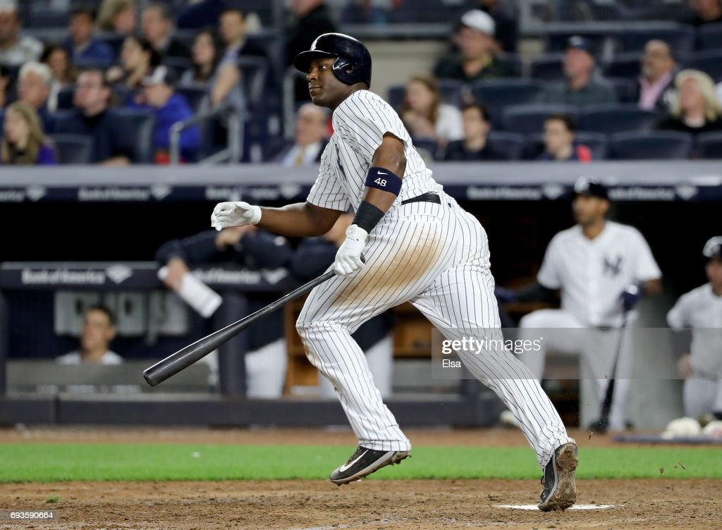 Chris Carter #48 of the New York Yankees drives in a run in the eighth against the Boston Red Sox on June 7, 2017 at Yankee Stadium in the Bronx borough of New York City.