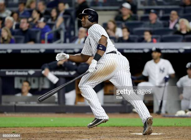 Chris Carter of the New York Yankees drives in a run in the eighth against the Boston Red Sox on June 7 2017 at Yankee Stadium in the Bronx borough...