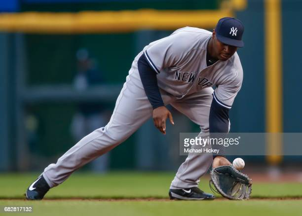 Chris Carter of the New York Yankees fields the ball during the game against the Cincinnati Bengals at Great American Ball Park on May 9 2017 in...