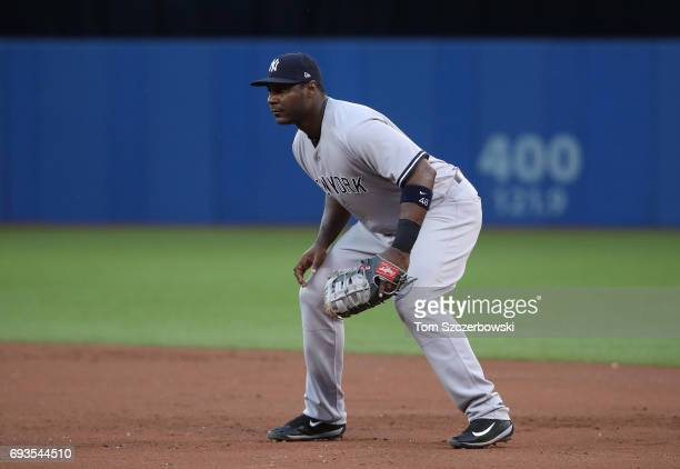 Chris Carter of the New York Yankees gets ready to field his position at first base during MLB game action against the Toronto Blue Jays at Rogers...