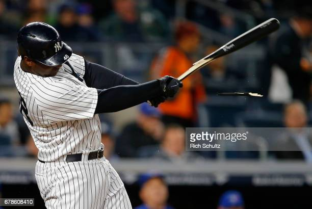 Chris Carter of the New York Yankees hits a RBI single in the seventh inning against the Toronto Blue Jays during a game at Yankee Stadium on May 3...
