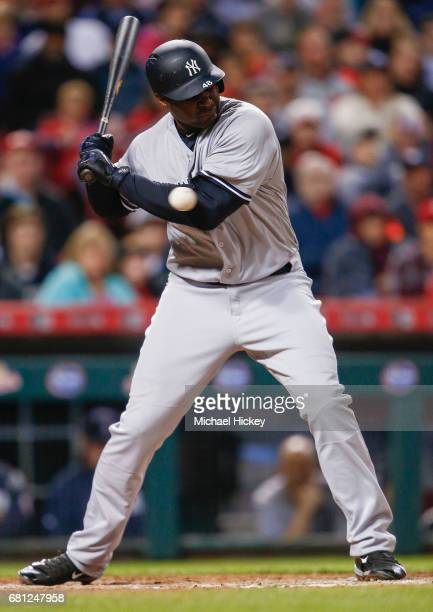 Chris Carter of the New York Yankees is hit by the pitch during the sixth inning of the game against the Cincinnati Reds at Great American Ball Park...