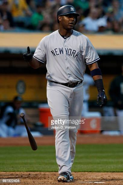Chris Carter of the New York Yankees reacts after striking out against the Oakland Athletics during the fourth inning at the Oakland Coliseum on June...